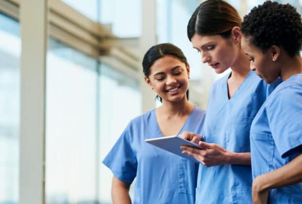 nurses discussing chart